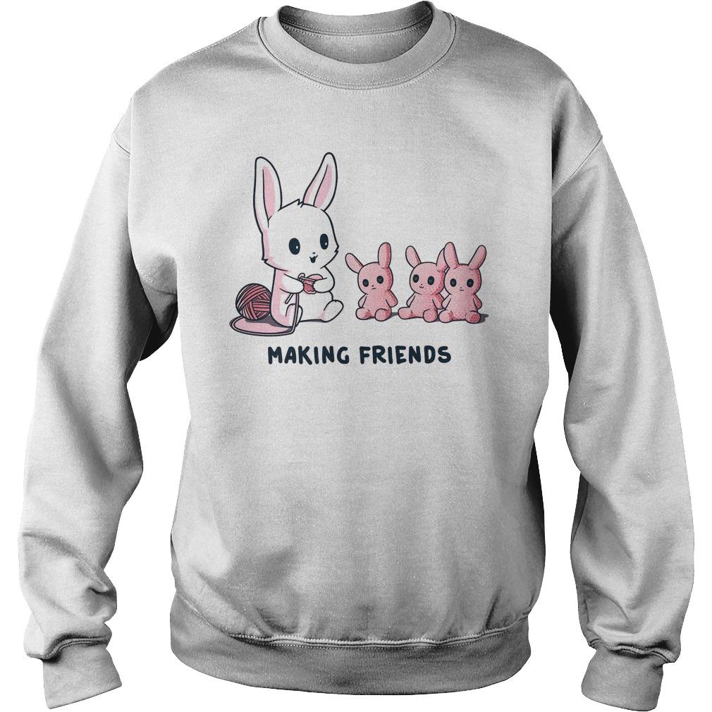 Baby rabbit making friends sweater